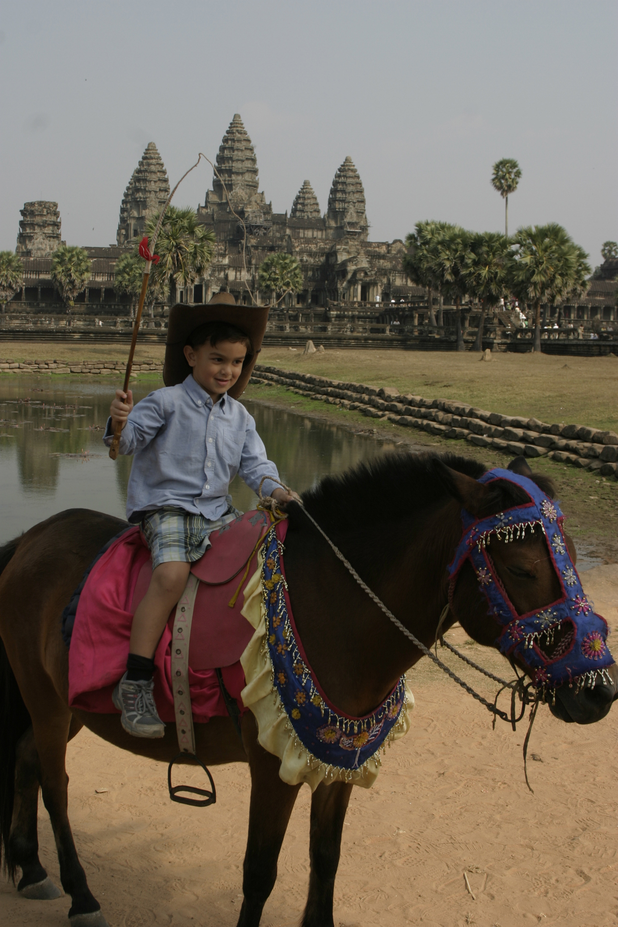 3_feb_2008__ld_on_pony_hat_and_whip_siem_reap_cambodia_angkor_wat_temple