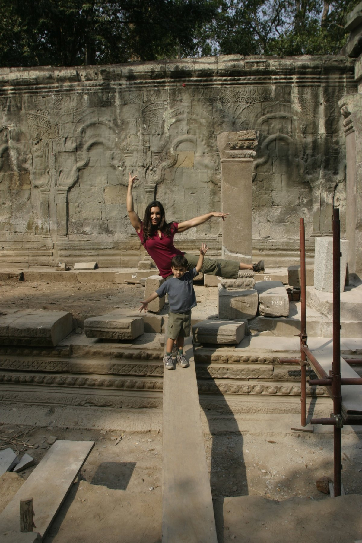 5-ld-and-cat-balancing-on-planks-remodeling-temples-feb-2008-cambodia10-24-2011