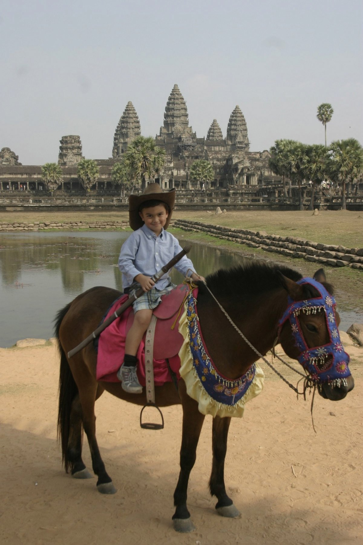 4-ld-with-sword-on-horse-angkor-wat-temple-cambodia-feb-20010-17-2011