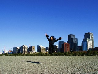cat_jumping_tokyo_skyline_japan_dec_2007