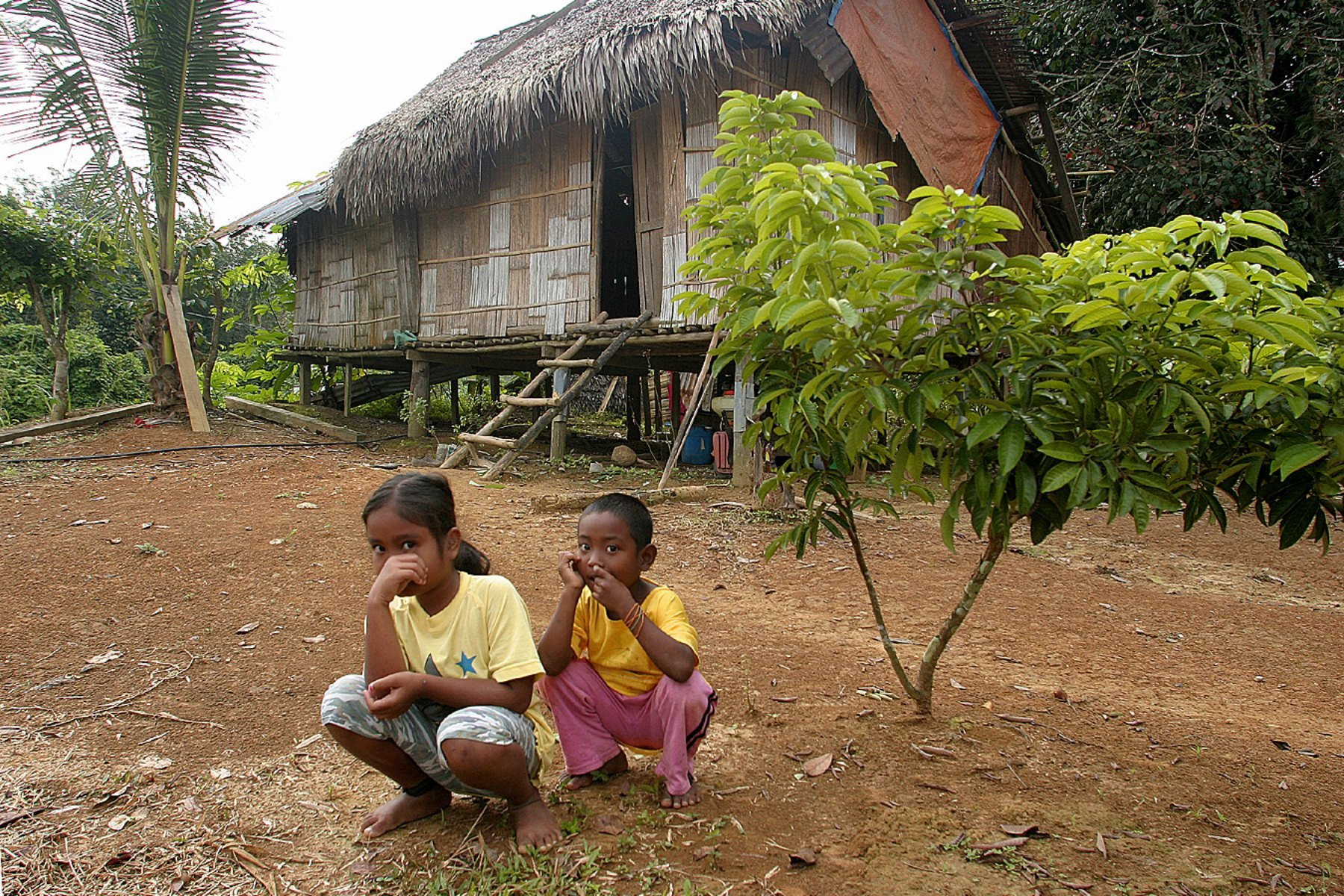 kids-infront-of-their-hut-small-file10-17-2011